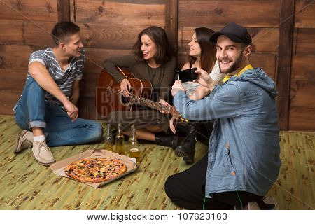 Happy friends spending their free time in good company