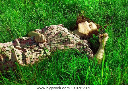 A Beautiful Girl Lies In A Green Grass