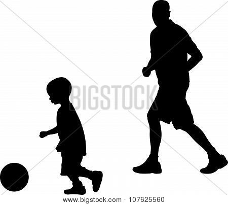 dad and son playing football