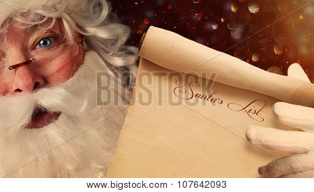 Closeup of Santa Claus holding a Santa List scroll