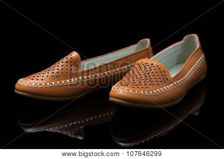 Orange women loafer isolated on black background