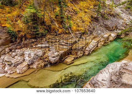 The green and clear water of the Maligne River