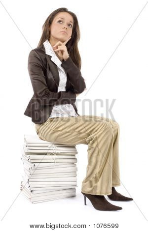 Woman Sitting On The Heap Of Files - Thinking