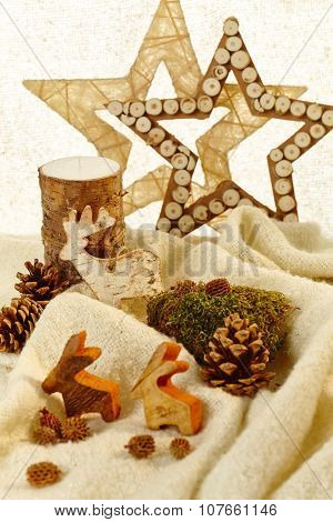 Natural christmas decoration with stars and autumn fruits.
