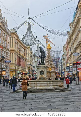 Graben Street And Hole Trinity Column In Vienna In Austria With Christmas Decoration In The Street
