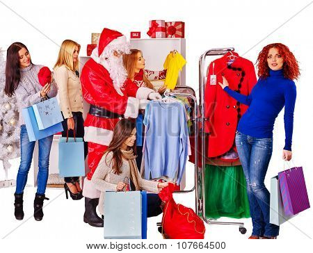Shopping women with Santa on Christmas sales do purchase.