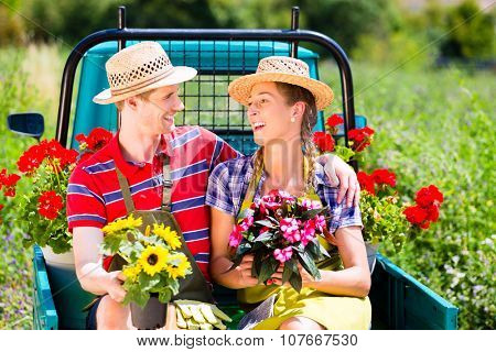 Couple in garden with flowers on gape