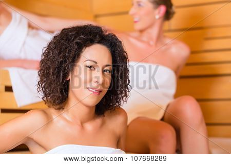 Woman enjoying wellness infusion in sauna