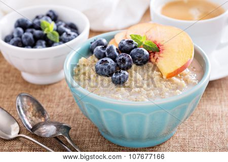 Breakfast quinoa porridge with fresh fruits