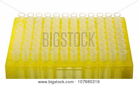 Yellow Rack Of Small Plastic Test Tubes