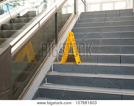Oviedo, Spain - November 1 2015: Foldable Plastic Wet Floor Sign Stands On The Stairs Step At The Fe