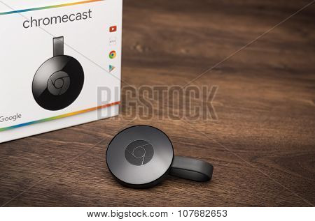 2nd Generation Google Chromecast Hdmi-dongle On A Wooden Surface