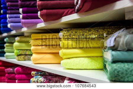 Rolls Of Fabric And Textiles In A Factory Shop Or  Store
