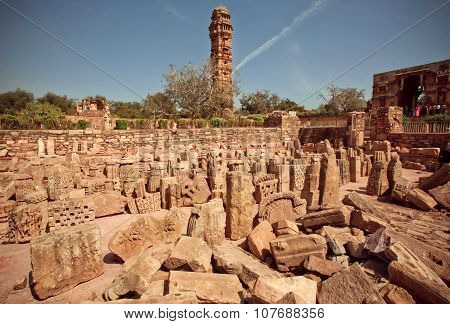 Ruins of hindu temples and tall building of 15th-century Tower of Victory in India, an UNESCO World