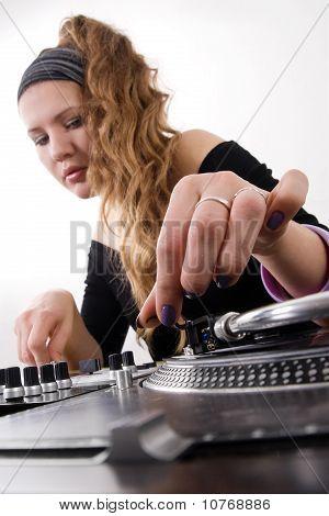 Female Dj Puts Needle On Vinyl Record