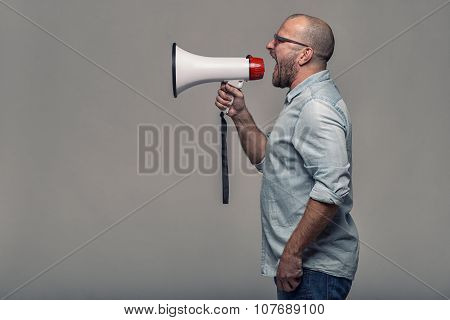 Man Speaking Over A Megaphone