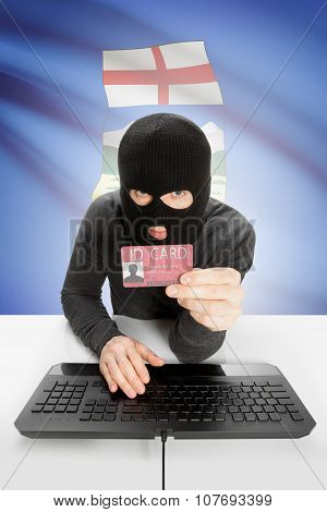 Hacker With Canadian Province Flag On Background Holding Id Card In Hand - Alberta