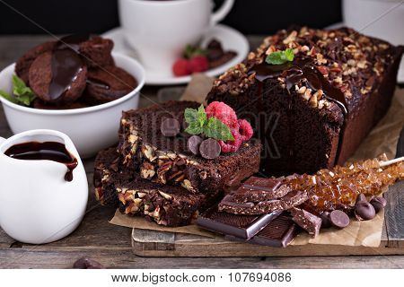 Chocolate loaf cake with pecan nuts and chocolate chips poster