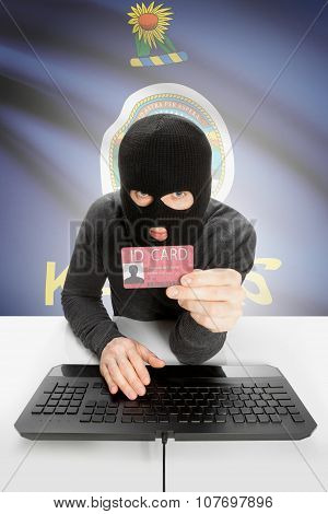 Hacker With Usa States Flag On Background And Id Card In Hand - Kansas