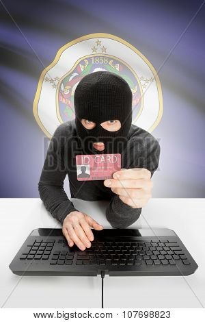 Hacker With Usa States Flag On Background And Id Card In Hand - Minnesota