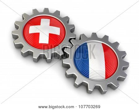 Swiss and French flags on a gears (clipping path included)