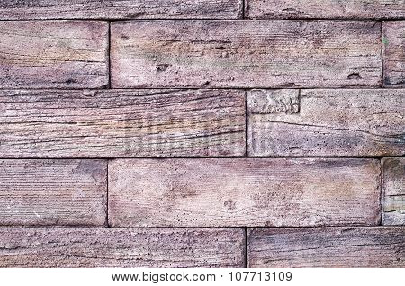 Decorative relief cladding slabs imitating old wood on wall closeup poster