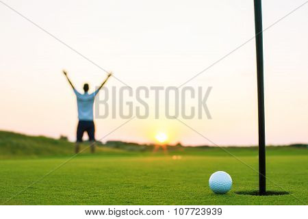 Happy Golf Player On A Golf Court At Sunset