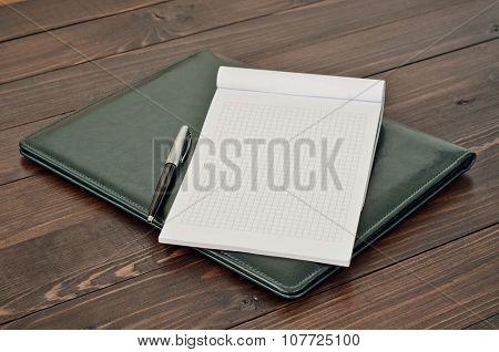Open Notepad With Blank Pages With A Pen