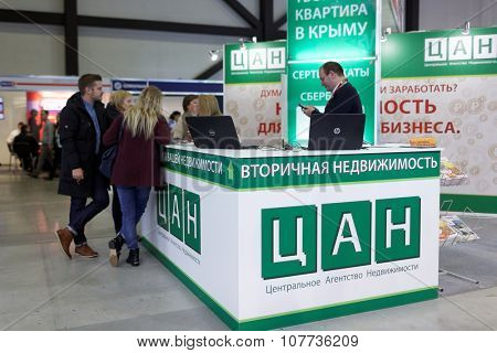 ST. PETERSBURG, RUSSIA - OCTOBER 31, 2015: Visitors at the desk of real estate resale agency CAN in the Expoforum during the Real Estate Fair. It is the largest real estate exhibition in Russia