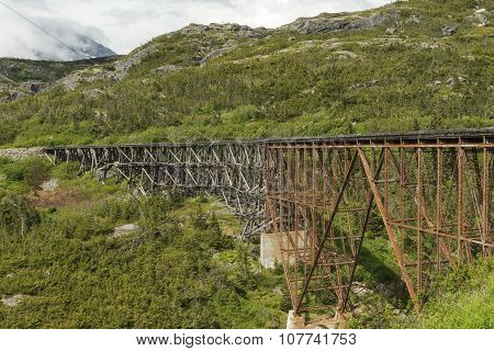 The White Pass and Yukon Route Railroad Bridge. The railroad is linking the port of Skagway Alaska with Whitehorse the capital of Yukon. poster