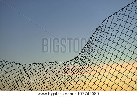Chain Link Fence On Evening Sky