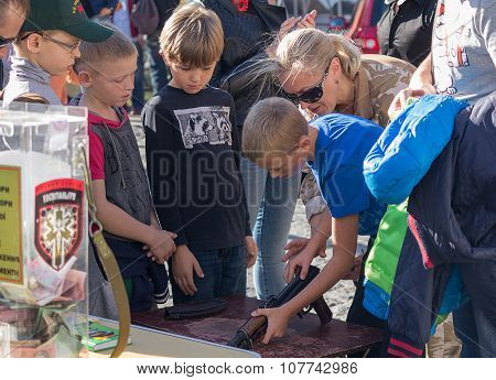 Kiev, Ukraine - October 03, 2015: Children Are Taught To Handle Weapons In The Street St. Andrew's D