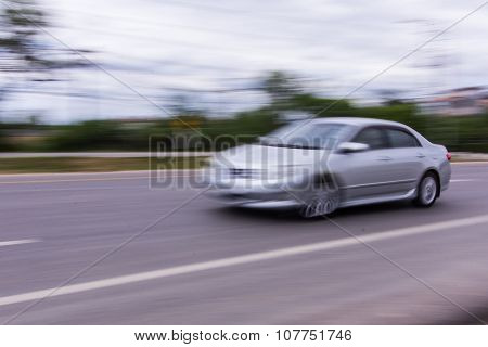 Car Speeding In Road