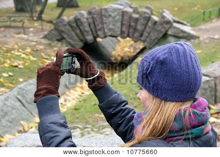 Girl With A Camera In Autumn