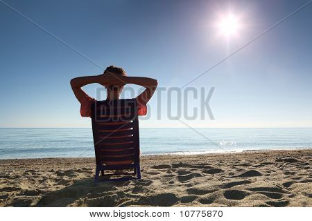 Woman Sits On  Plastic Chair Heaving Up Hands For  Head By  Person To  Sea