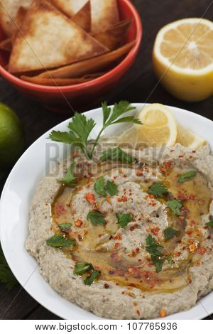 Baba ghanoush, levantine baked eggplant dip with olive oil and parsley