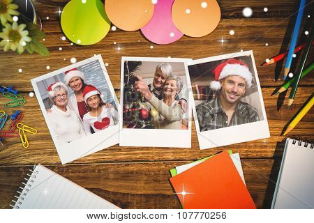 Snow against overhead view of office supplies with blank instant photos