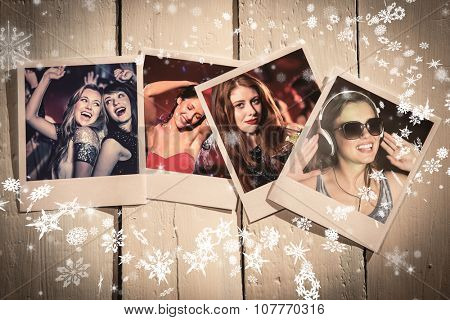 Instant photos on wooden floor against happy friends having fun together