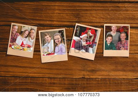 Instant photos on wooden floor against portrait of grandmother father and son
