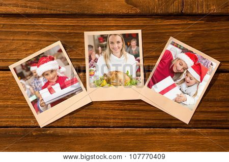 Instant photos on wooden floor against festive daughter holding pile of gifts with his family behind