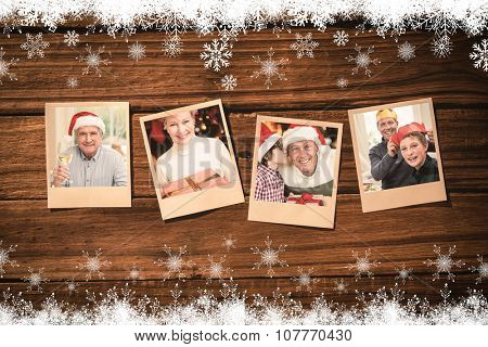 Instant photos on wooden floor against smiling mature man in santa hat toasting with white wine