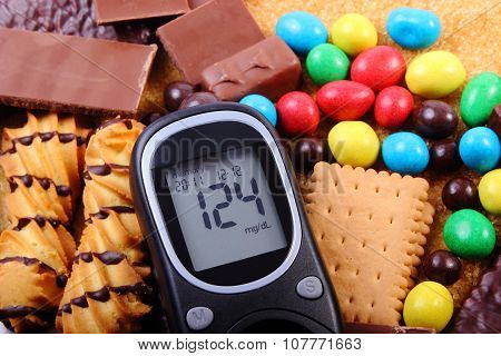 Glucose meter heap of candies cookies and brown cane sugar too many sweets unhealthy food concept of diabetes and reduction of eating sweets poster