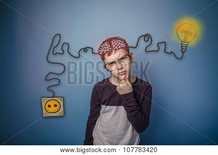Teenage boy in glasses thinking brain booster charge charging pl