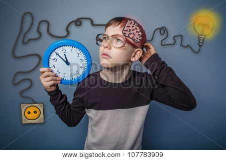 Teenage boy scratching his head and holding a clock booster char