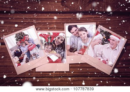 Smiling little girl with her father holding a Christmas gift against blue periodic tablet with dna strand