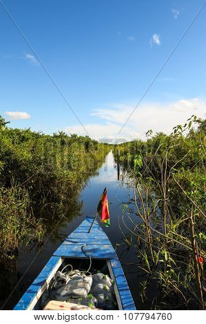 Boat Crossing The Amazon.