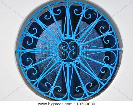 Round Window With A Blue Grid