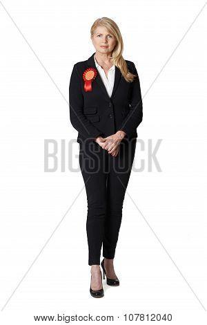 Full Length Portrait Of Female Politician Wearing Red Rosette
