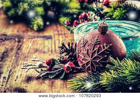 Christmas border design on the wooden background. Christmas fir tree with christmas candle and decor