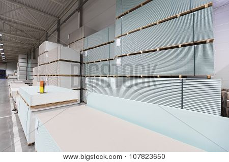 Warehouse With Piles Of Construction Plasterboard
